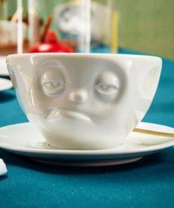 Tasse en porcelaine fatigué